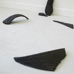 work by Lucy Whitford, Shedding (of shade), 2012, black fired clay